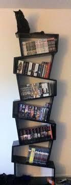 A real cool bookshelf d still a sky high pile of books next to