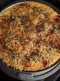 Put Down 1 4 Later Of Shredded Mozzarella On A Non Stick Pizza Pan Bake At 425F For 20 Minutes Or Until Browned And Crispy I Chose To Mix In Garlic