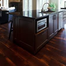Rustic Modern Kitchen Design With Wide Plank Distressed Oak Hardwood Flooring Tiles And Dark Brown Island Microwave Storage Black Marble Countertop