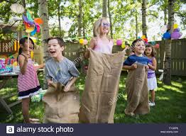 Kids Enjoying Sack Race At Backyard Birthday Party Stock Photo ... Camping Birthday Party Fun Pictures On Marvellous Backyard Adorable Me Inspired Mes U To Cute Mexican Fiesta An Oldfashion Party Planning Hip Mommies Ideas For Adults Design And Of House Best 25 Birthday Parties Ideas On Pinterest Water Domestic Fashionista Colorful Soiree Parties Girl 1 Year Backyards Enchanting Decorations For Love The Timeless Decor And Outdoor Photo