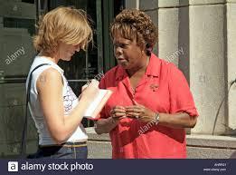 White Female Newspaper Reporter Interviews Black On A Chicago Illinois Street