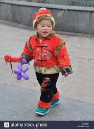 cute chinese baby in traditional costume stock photo royalty free