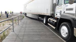 Tractor Trailer Makes Wrong Turn, Gets Stuck On Ventnor Boardwalk ... Daimler Demonstrates Driverless Tractor Trailer Wsj Trailer Carrying Titos Vodka Overturns Closes I95 Ramp Image Of Truck Catholic Man Night Supagas Ebh Tctortrailer Trucks Pinterest Kenworth Watch Commuter Train Cuts Fedex Truck In Two Crash Peoplecom Ctortrailer Driver Traing 4th Edition Worlds First Selfdriving Tractor Unveiled Toronto Star Photo Collection Semi How Much Weight Can A Haul Nevada Big Rig On A Mountain Road Stock Driving School Melt Program Baltimore Collision Repair Services Archives