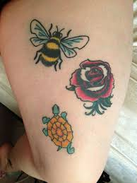 Traditional Bumblebee With Rose Tattoo On Right Thigh