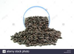 Many Coffee Beans On The White Background With Transparent Jar