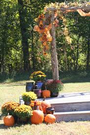Rustic Country Fall Wedding Arch Decorated With Sunflowers Grapevines Orange Tulle Crocks