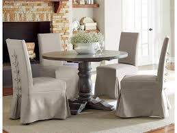 Muses 5-Piece Round Dining Table Set With Slipcover Parsons Chairs By  Progressive Furniture At Lindy's Furniture Company Ding Room Chair Covers From Pillowcases Jackie Home Ideas Serta Reversible Stretch Suede Slipcovers Short Skirt Parsons Chair Slipcovers Miss Mustard Seed Decor Beautiful Parsons Hd For Your Clothman For Printed Elastic Antistain Removable Washable Fniture Protector Linen Uk Chairs Kitchen And Tie Back And Corseted A Fun Way To Dress Up Sew Design Teal How Make A Custom Slipcover Hgtv Slipcover Tutorial How Make Set Of 2 High Elasticity Flowery