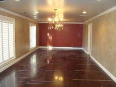 Red Accent Wall With Tan Walls Wood Flooring