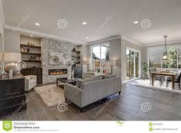 wohnzimmer grauer boden braune mobel caseconrad