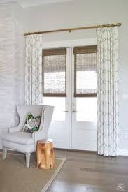 my favorite inexpensive brass curtain rods and white curtains too