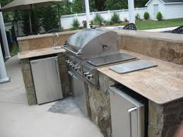 Kitchen L Shaped Covered Outdoor Stainless Steel Bbq Grill Natural Stone Fireplace Mantel Brown