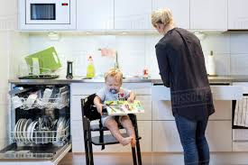 Mother Working In Kitchen While Baby Boy Sitting On High Chair Stock Photo Barstoolri Bar Stool With Backrest Solid Wood Frame Ftstool Ding Chair High Stools Yellow Pp Seat Kitchen Folding Step Simple Special Home Goods Square Base Blackpaddedfdinghighchairbreakfastkitchenbarstool Counter Swivel Backless Round Tables 2x Wooden Cafe Padded Gas Lift Black Baby Stepup Helper Espresso Washing Room Buy For Kids Hairkitchen Chairwooden Product H4home Rustic 2 Pcs Acacia Chairs H4home Fnitures Design Redation And Lifting Height Fashion Metal Front Evolu High Chair Pu Leather Gaslift