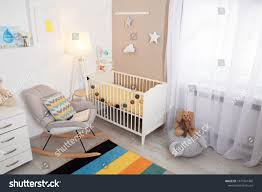 Cozy Baby Room Interior Crib Rocking   Interiors Stock Image White Glider Rocker Wide Rocking Chair Hoop And Ottoman Base Vintage Wooden Baby Craddle Crib Rocking Horse Learn How To Build A Chair Your Projectsobn Recliner Depot Gliders Chords Cu Small For Pink Electric Baby Crib Cradle Auto Us 17353 33 Offmulfunctional Newborn Electric Cradle Swing Music Shakerin Bouncjumpers Swings From Dolls House Fine Miniature Nursery Fniture Mahogany Cot Pagadget White Rocking Doll Crib And Small Blue Chair Tommys Uk Micuna Nursing And Cribs