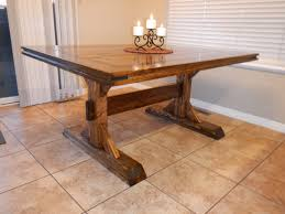 Small Rectangle Custom DIY Distressed Farmhouse Dining Table With Double Pedestal And Black Metal Candle Holder For Minimalist Room Spaces Ideas