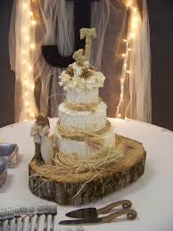 Rustic Wedding Cake With Straw On Wood Slab