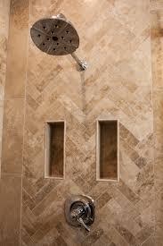 a herring bone travertine tile pattern thetileshop bathroom
