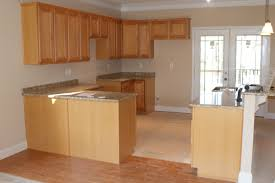 recycled countertops light brown kitchen cabinets lighting