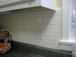 white subway tile backsplash on kitchen with on 2