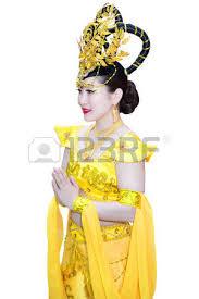 beautiful asian woman in traditional chinese yellow dress making