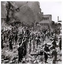 Lines of people standing amid remains of the Central Post fice