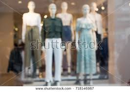 Blur Womens Fashion Store Background Blurred Picture Of Female Mannequins Standing In A Shop Window