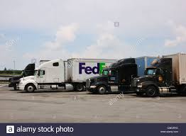 UPS And Fedex Trucks, USA Stock Photo: 50069360 - Alamy Fedex Truck Court Says Ground Drivers Are Employees Not Contractors In Trucks Route 66 Hwy Arizona Youtube A Train Just Oblirated A Utah After Signal Commuter Train Smashes Into Truck And Cuts It Two Cnn 12 Secrets Of Delivery Drivers Mental Floss Fedex Ground Classic Xl Skin Mod For American Simulator Ats The On Catalina Island Is Adorable Imgur For Sale Ford Cutaway Fedex Charged With Conspiracy To Deliver Illegal Prescription Drugs Wants The Us Government Develop Selfdriving Laws File20080730 Trucks Docked At Rdujpg Wikimedia Commons
