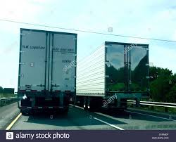 Two Tractor Trailer Trucks Driving In Tandem On Illinois Highway ... Tctortrailer Truck On A Us Inrstate Highway Stock Photo Truck Trailer Transport Express Freight Logistic Diesel Mack Challenges American Simulator Tamiya America Inc Fuel Tank Trailer 114 Semi Horizon Hobby Tractor Wash Detailing Custom Chrome Texarkana Ar Unit Wikipedia Nozone Areas Indianapolis Circa September 2017 Colorful Cars Truck Tractor Trailer Red Pixar Android Wallpapers Amazoncom Log Diecast Replica 132 Scale Assorted