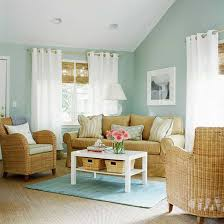 soft light blue wall colors with rattan chairs blue living room
