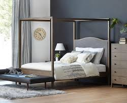 The Petra canopy bed features a modern wood canopy frame with