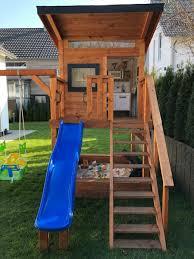 spielhaus mit schaukel sandkasten veranda häuschen mit