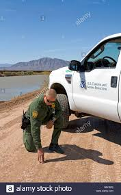 U S Border Patrol Agent Checking For Footprints At The U S Mexico ... On The Road I5 California Part 4 Rocha Trucking Parking Inc Calexico Wikiwand Us Mexico Border Usa Illegal Immigrants Just Captured In The Rub Home Facebook Intertional Cars For Sale Tractor Trailer Rentals San Diegocalexico May 2013 Kudos Transportation Gsas Border Facility Renovations Projected To Thin Cgestion At Tulagi Boulder Colorado 61201 Concert Posters For Kogi Bbq Truck La Eat Here Pinterest Food Truck And Perry Avenue Mapionet