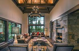 Rustic Living Room With High Ceiling Stone Fireplace And Wood Flooring