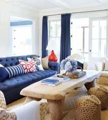 nautical living room decorating with navy blue tufted sofa