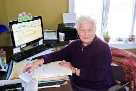 Travel Agent Nina Kraus At Work In Her Home Office DANA SHAW
