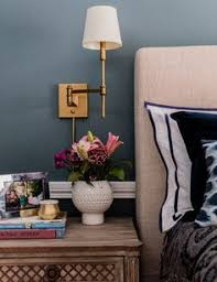 Gorgeous wall color for a bedroom with light and tailored furniture