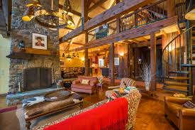 Rustic Great Room With Exposed Beam Hardwood Floors Built In Bookshelf Stone