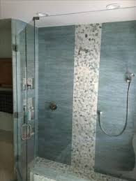 stunning shower remodel using sliced sea green and white pebble