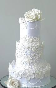 lace cut wedding cake by Fainazcakes