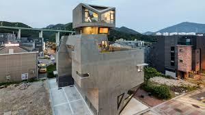 104 South Korean Architecture Moon Hoon S Concrete Housing Block In Korea Has Owl Like Features