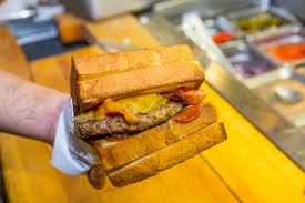 100 Grill Em All Food Truck This Death Metal Burger Joint Is Ed Meat Valhalla On Earth