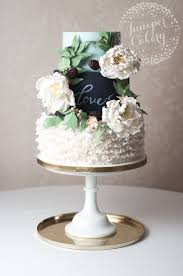 Rustic Chalkboard Wedding Cake With White Open Peonies Peach Blossoms And Seeded Eucalyptus By Juniper