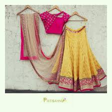 Gorgeous Yellow Lehenga With Bright Fuchsia Blouse And Nude Dupatta