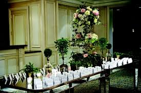 Seating Cards On Long Mirror Table With Tall Flowers Short Floral Arrangements