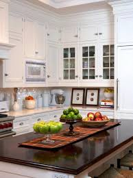 White Kitchen Cabinets And Dark Countertop Island Decorating With Fall Fruits Vegetables