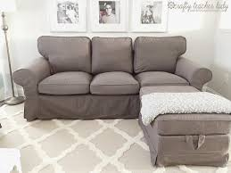 light grey leather sofa plus fabric chesterfield together with