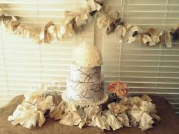 Rustic Burlap Wedding Decorations With Two Tier Cake And Small Coral Flower Under Hanging Ornaments