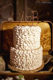Photography By Katelin Wallace Rustic White Ruffled Cake With Wire Twine Initial Topper