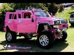 Pink Hummer H2 with miniature poodle on the passenger seat