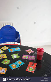High Chair At Table With Child's Jigsaw Puzzle Stock Photo ... Jigsaw Puzzle Table Storage Folding Lting Adjustable Amazoncom Ayamastro Multicolor Kids 5pcs Ding 235 Block Puzzle Indoor Games For 1 Chair Making Jaipurthepinkcitycom Massive Area And Giant Table Chairs Moneysense Hiinst Malltoy 2017 New Hot Kid Children Educational Toy Expert Wooden Tiltup Easy Storage Work Surface Accessory Vintage Fomerz Japan Fniture 7 Pcs Studyset Tables Creative Us 1196 13 Offwooden 3d Miniature Model Home Chairtabledesk Diy Assembly Development Abilityin Childrens Animal Eva Set Details About Unfinished Solid Wood Child Toddler Activity Play