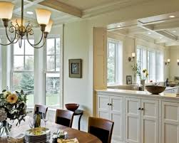 Elegant Kitchen Wall Decorating Ideas Featuring Picture Frames And Exotic Sconces